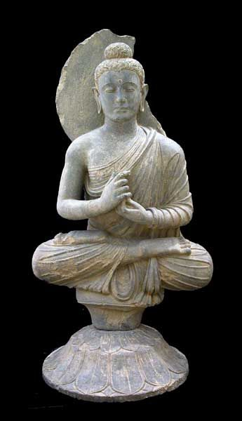 Dharmachakra Mudra (teaching the way of enlightenment). Gandhara Schist Sculpture of the Buddha, Afghanistan/Pakistan ca. 2nd Century AD to 4th Century AD.