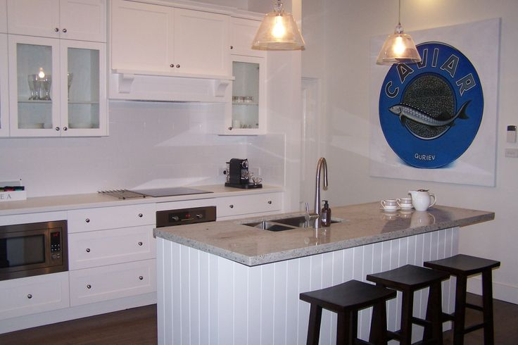 Kitchen with large caviar painting