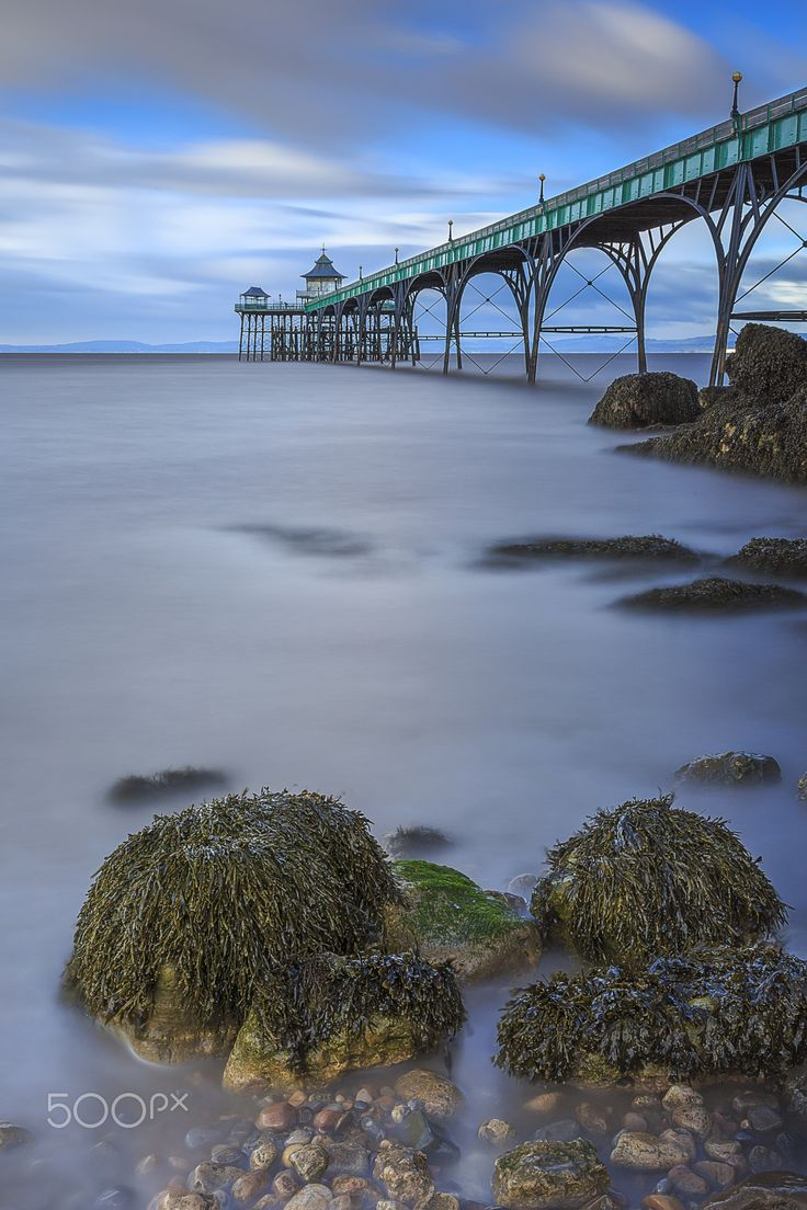 Clevedon Pier, by Rich Wiltshire... #beach #blue #clevedon #clevedonpier #clouds #coast #england #landscape #landscapes #light #longexposure #ocean #pier #rocks #sea #seascape #sky #somerset #sunset #water #waves