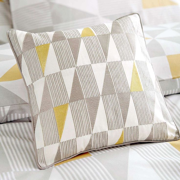 Our Yellow Skandi Geometric Square Cushion is the perfect addition to any bedroom.