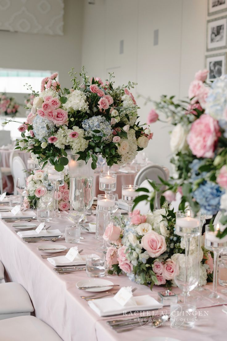 Beautiful centrepieces at Malaparte with soft pink accented with dusty blues by Rachel A. Clingen.