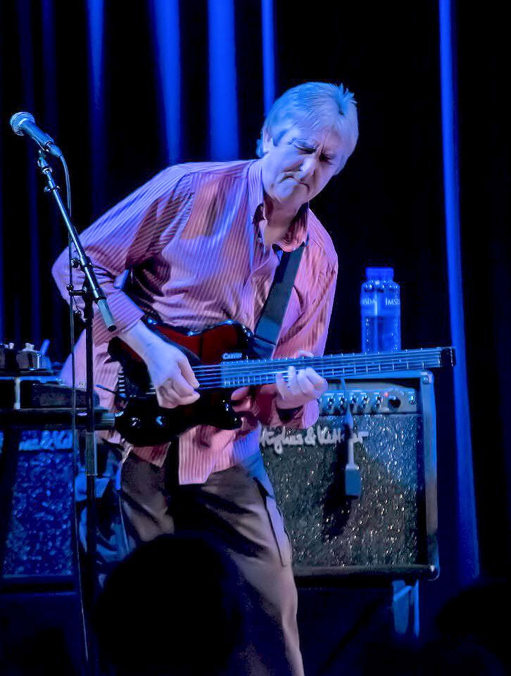 Allan Holdsworth  In the eyes of a lot of people around the World, this man is the greatest man to have ever picked up an electric guitar. Nobody comes close, except maybe Guthrie Govan, but Allan's in a league of his own.