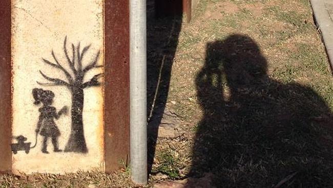 Banksy-style artwork on a Stobie pole in Banksy on Stobie poles in Lamorna Tce, Largs Nor