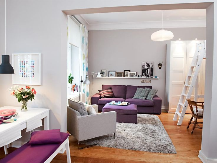 Hardwood floor design for a living room with grey and purple furniture sets