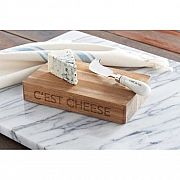 """C'est Cheese Board Set, Wood  So clever and so cute! Just the right size, this chunky acacia wood board is etched with the witty """"C'est cheese"""" message on the sides and comes tied with a darling ceramic handled spreader embossed with """"merci."""""""
