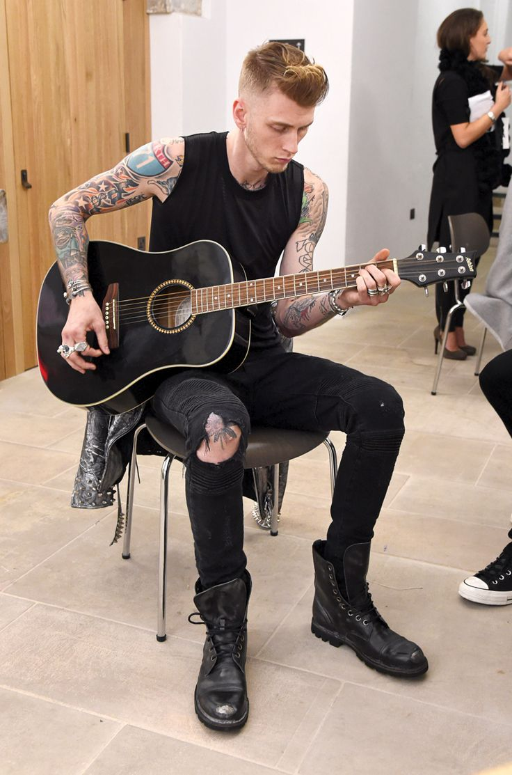 LONDON, ENGLAND - JANUARY 08: Machine Gun Kelly backstage following the Joshua Kane Bespoke with Lab Series runway show during London Collections Men AW16 at Christ Church Spitalfields on January 8, 2016 in London, England. (Photo by David M. Benett/Dave Benett/Getty Images for Joshua Kane with Lab Series)