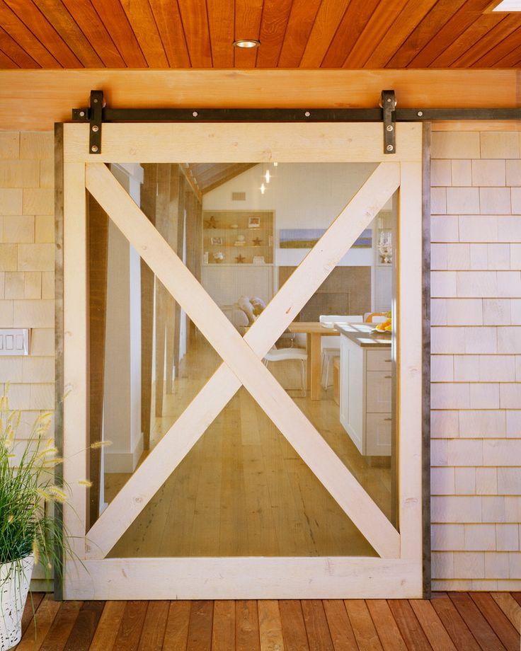 Barn doors interior in entry beach with shingles batten for Barn door screen door