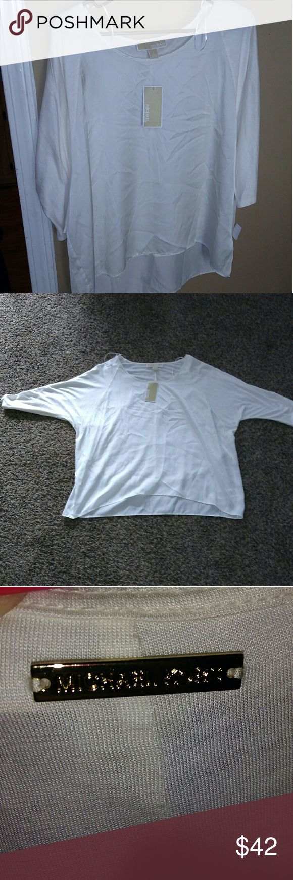 Michael Kors Slouchy Top ? NEW WITH TAGS!! Cream color. 3/4 sleeve. Size Large. The front is sheer (feels a little like satin). The back has the gold MK logo on the neckline. This can be dressed up or down with leggings, jeans, or pencil skirt. BRAND NEW WITH TAGS.  I love to Bundle and open to offers! Happy Poshing! Michael Kors Tops