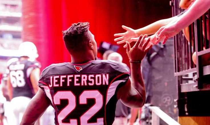 Oct 2, 2016; Glendale, AZ, USA;  Arizona Cardinals strong safety Tony Jefferson (22) high fives fans prior to the game against the Los Angeles Rams at University of Phoenix Stadium. Mandatory Credit: Matt Kartozian-USA TODAY Sports