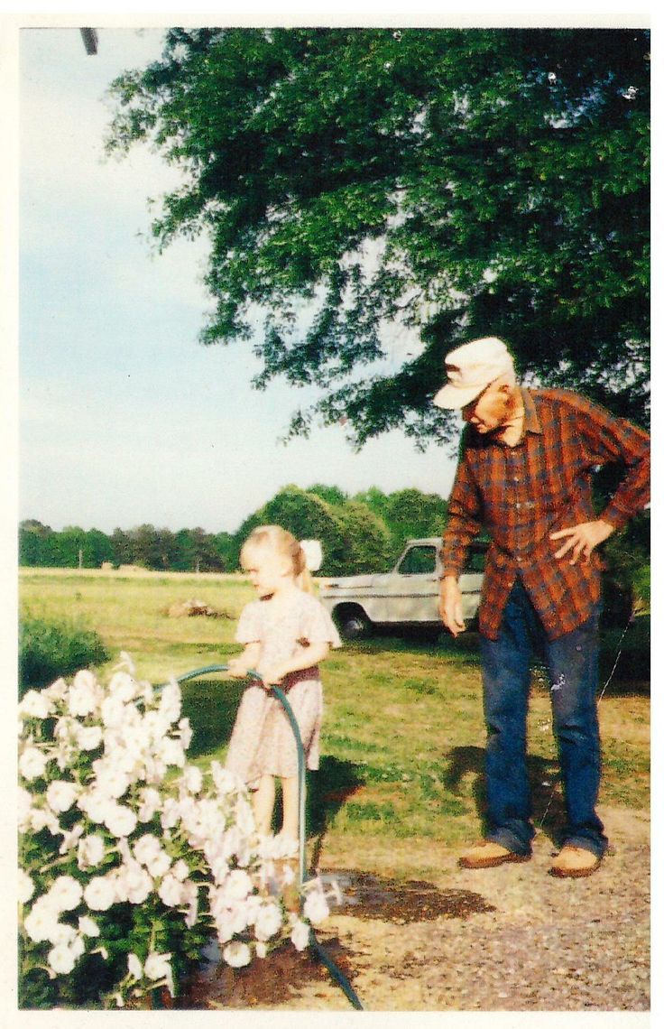 Taken many years ago when Hilary was young and Papaw Ritter was still with us. On his farm off Cotton Gin Port Road.