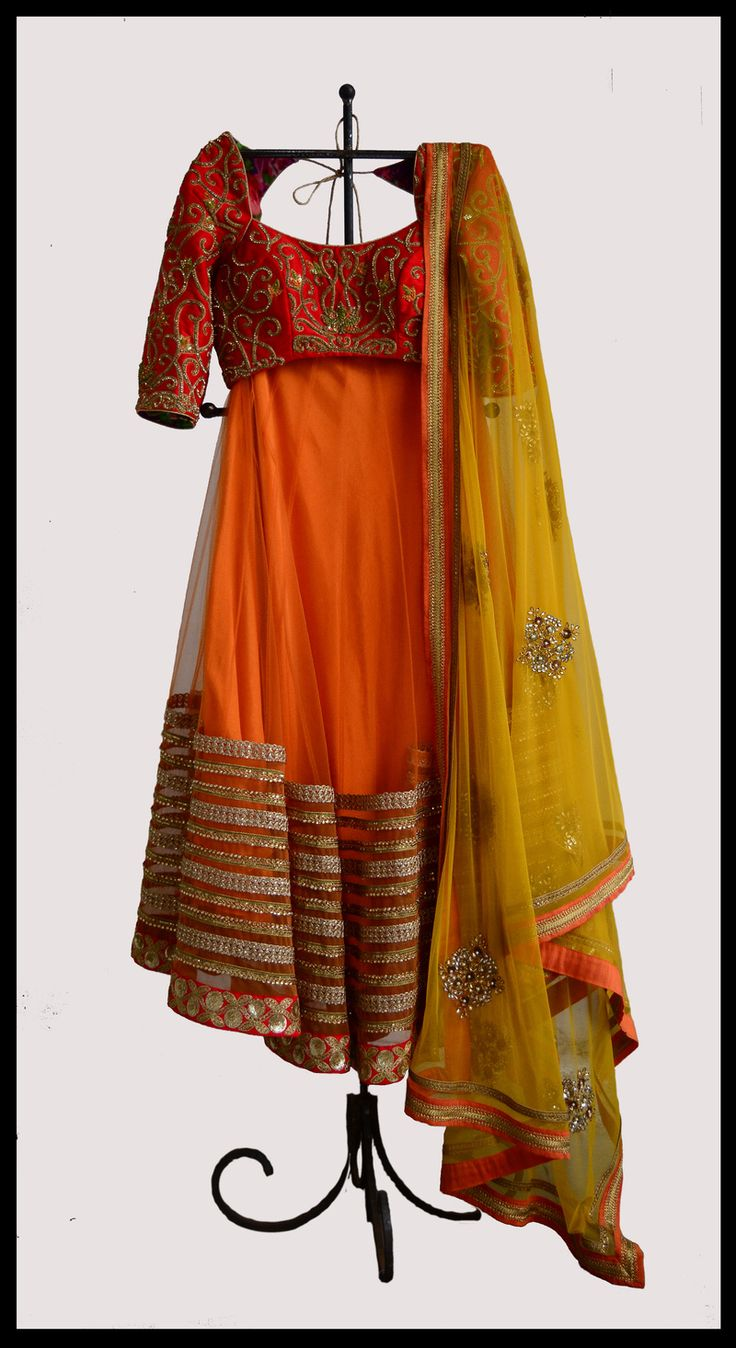 Red & Orange Lehenga | WedMeGood Beautiful Red Blouse with Gold Embroidery, Orange Lehenga with Gold Border and Yellow Net Dupatta #wedmegood #lehenga