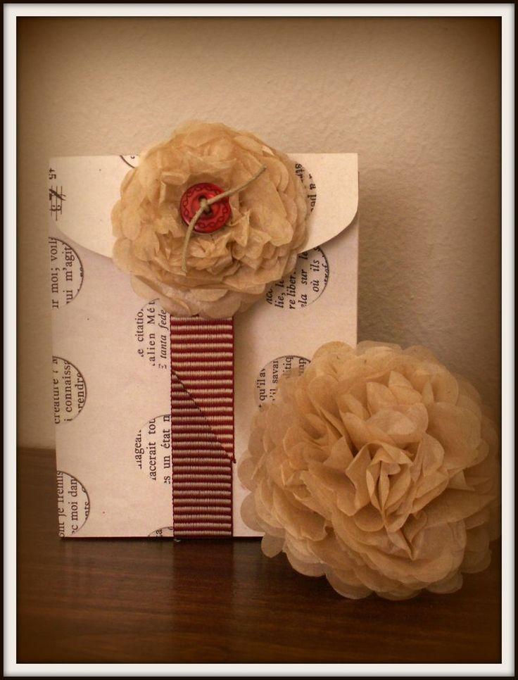 Craft Fair Idea:  Create several paper flower/button ribbons to put on presents.