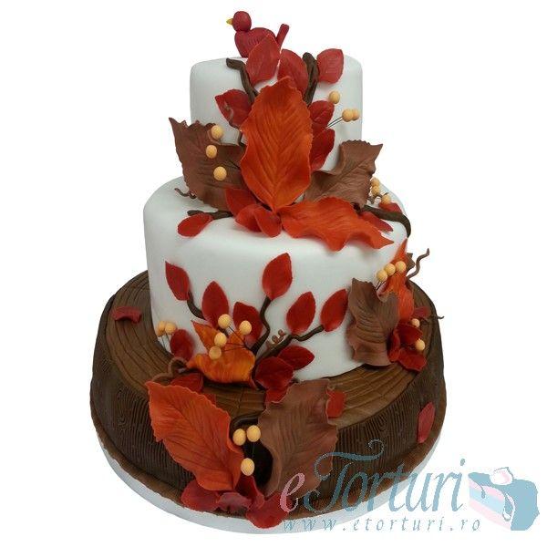 Un tort special cu tema toamna si cu flori realizate in laboratorul nostru petala cu petala. Pentru acest tort, manopera se plateste separat. Pentru detalii, click aici: http://etorturi.ro/produse/torturi-noi/tort-de-nunta-tema-toamna/