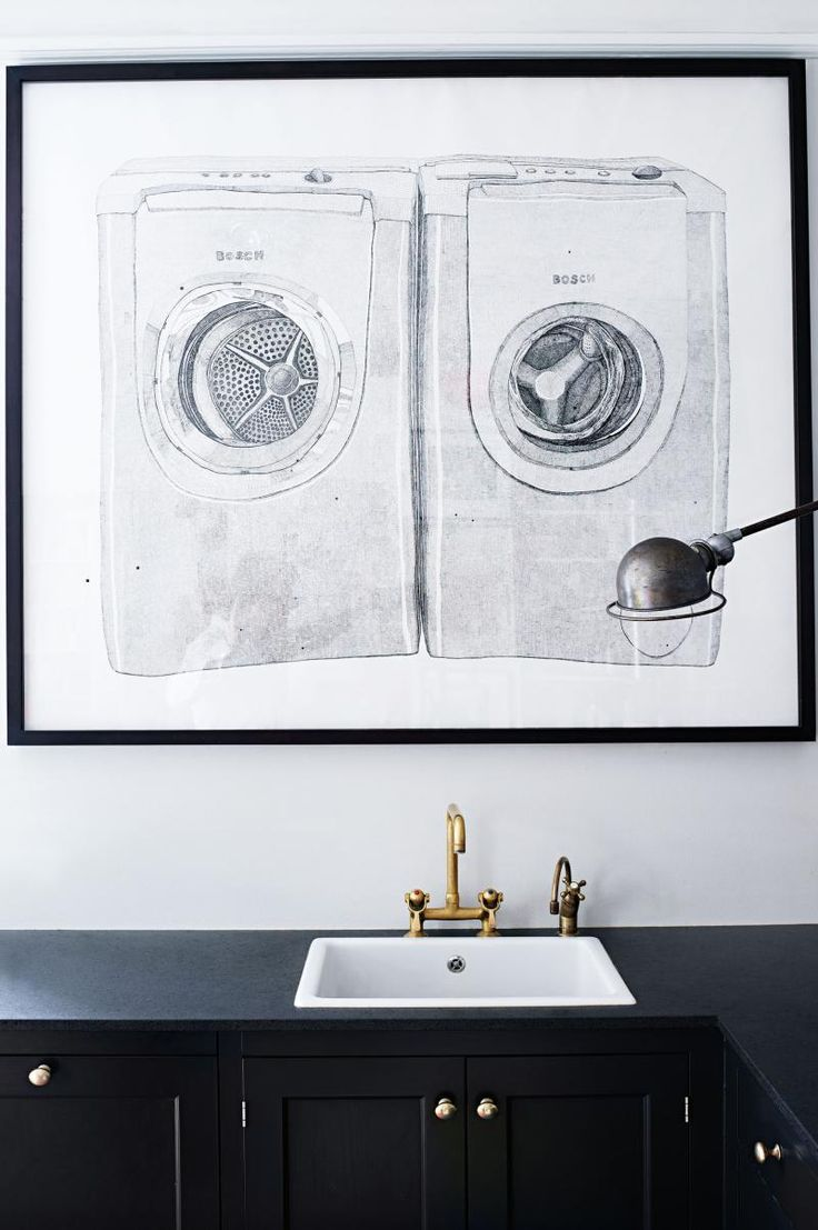 Kitchen sink with matching black glass tap landing and sliding cover - Copenhagen Apartment Black White Kitchen Bench Gold Tap Artwork Dark Cabinets And Raven Countertop Contrasted