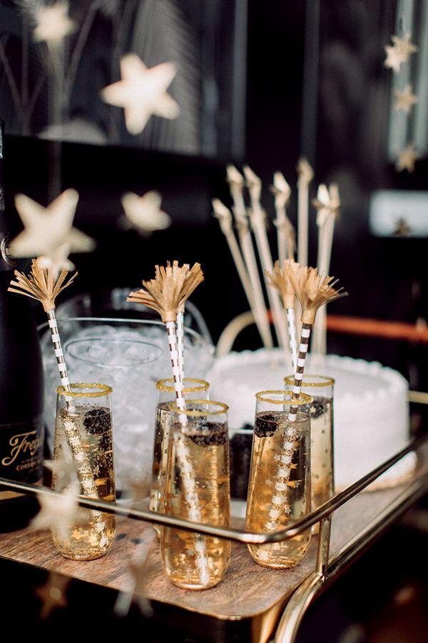 DIY Star Champagne Flutes  https://ruffledblog.com/diy-star-champagne-flutes #nye #holidayparty #diy