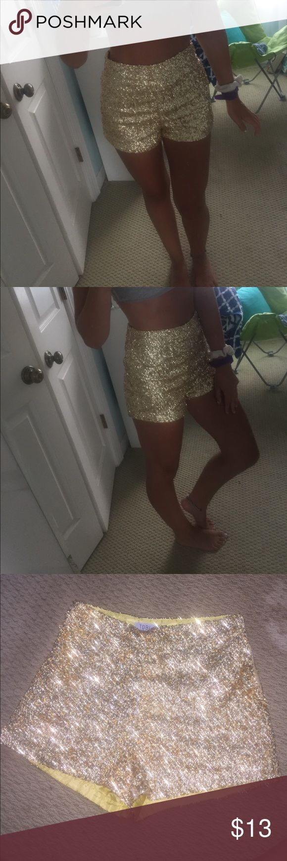 High waisted glitter shorts Very festive gold glitter high waisted shorts from Tobi! There are a couple of snags from the sequins but nothing noticeable. These shorts are my favorite to go out in but they don't fit me anymore! Tobi Shorts