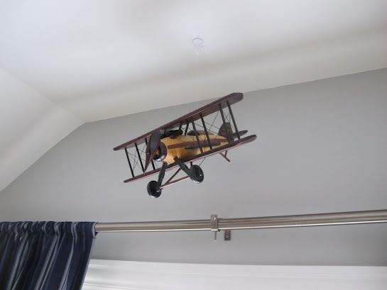 vintage airplane boys room/hobby lobby plane hung with fishing wire