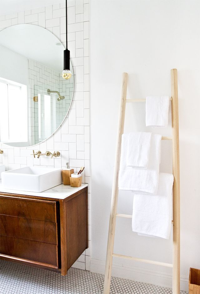 Ladder for handtowels, beautiful sink and subway tile !