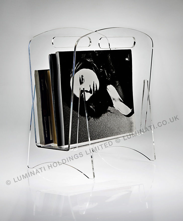 A magazine rack made in clear acylic throughout.  Stylish lifestyle product for any home.  Made and designed in Great Britain by Luminati.co.uk