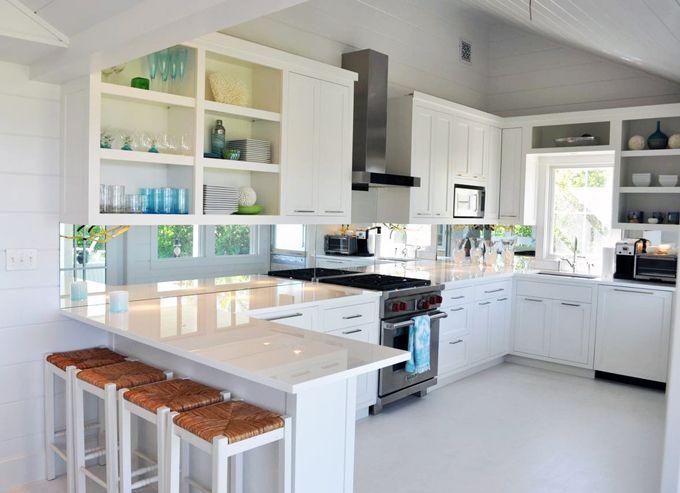 Love the mirrored splashback in this kitchen.