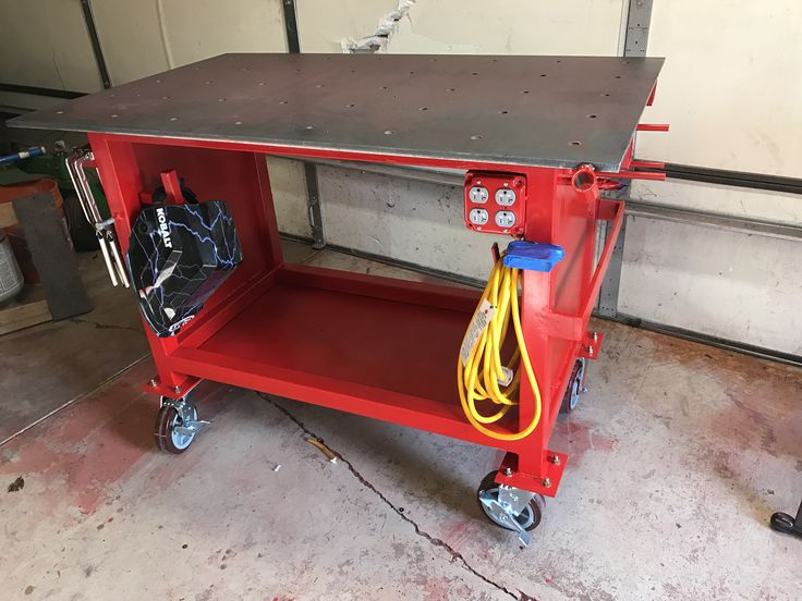After many weeks of deliberating design- I finally built my welding table.
