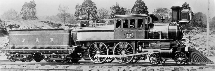 The locomotive. It's is a D class, Wooten boilered, 4-4-0, probably manufactured at Baldwin over along VIADUCTgreene's City Branch. Check out the fancy, arch-windowed walnut cabs and long cow-catchers.