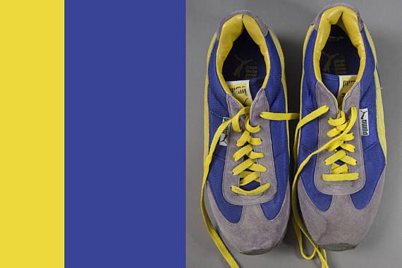 Happy ,bright , three colour PUMA running shoes. The mauve and yellow pattern is a suede leather and the dark mauve/blue colour is nylon. The condition is good ,they have a gentle wear a little bit of dirt. The size is mens US 9 1/2, euro 42 1/2 Shipping - I will ship international
