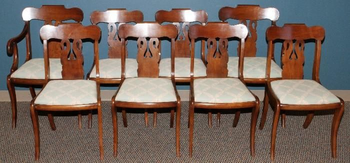 Found on EstateSales.NET: Lot#2124, EMPIRE MAHOGANY SET OF EIGHT DINING CHAIRS//Two arms and six sides, all with slip seats and sabre legs. Back splats have swan form motif. Circa 1910.