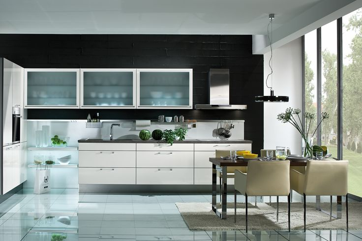 Introducing hints of nature into a kitchen can help to warm up what could be a stark space