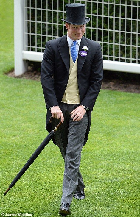 Prince Harry grins as he makes his way through the Royal Enclosure