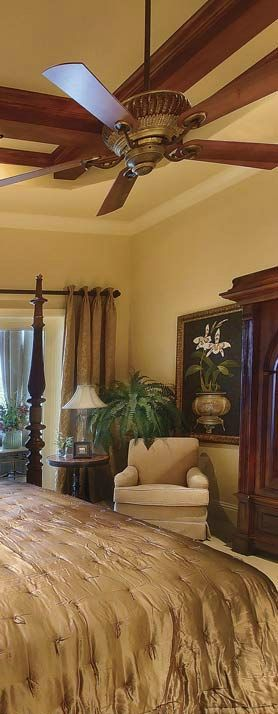 Gorgeous Tuscan Master Bedroom!  Beautiful bedding, draperies, artwork and a reading nook!