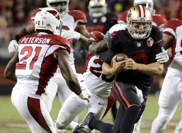 Thursday Night Football: Cardinals vs. 49ers  -  October 6, 2016:  33 - 21, Cardinals  -    San Francisco 49ers quarterback Blaine Gabbert (2) carries against Arizona Cardinals cornerback Patrick Peterson (21) and strong safety Deone Bucannon, rear, during the second half of an NFL football game in Santa Clara, Calif., Thursday, Oct. 6, 2016.
