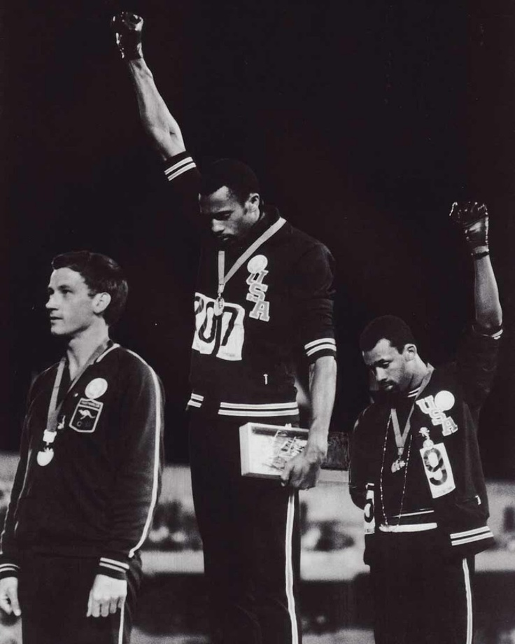 """The clenched fist salutes of Tommie Smith and John Carlos at the 1968 Olympic Games in Mexico is one of the defining images from a year of global protest. Despite its ubiquity it has lost none of its extraordinary power. Muhammad Ali, who knew a thing or two about both the Olympics and racism in the United States, said that it was """"the single most courageous act of the century."""""""