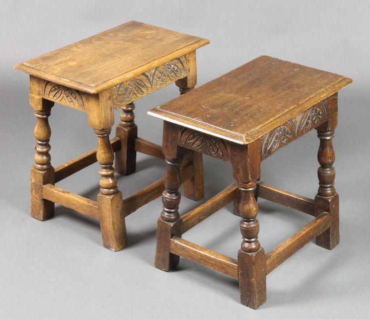 "Lot 902, A pair of very similar rectangular carved oak joined stools raised on turned and block supports 17""h x 18""w x 12"", sold for £200"