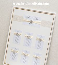 wedding table plan with brooches