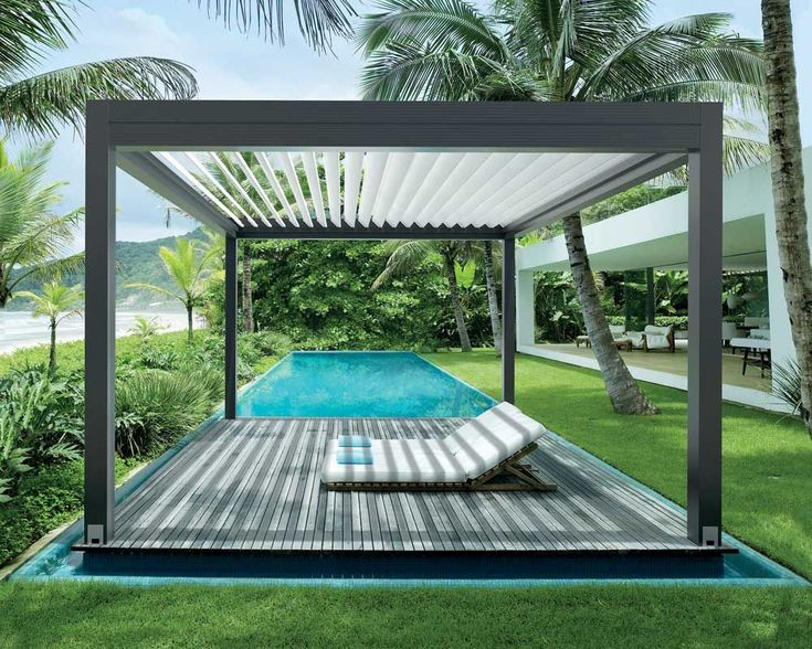 Pool with operable louver pergola