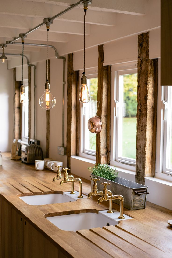 i love the lighting ( maybe for over the island or dining table)  Beautiful twin sinks with deVOL Aged Brass Mayan Taps