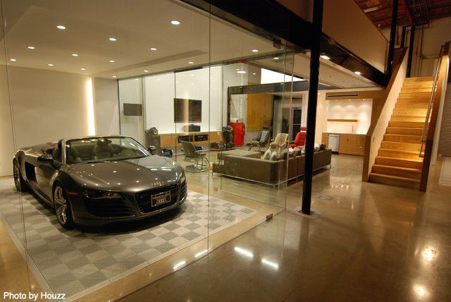 This remodeled garage has been transformed into the ultimate hang out with a spacious spot for the beautiful Audi.