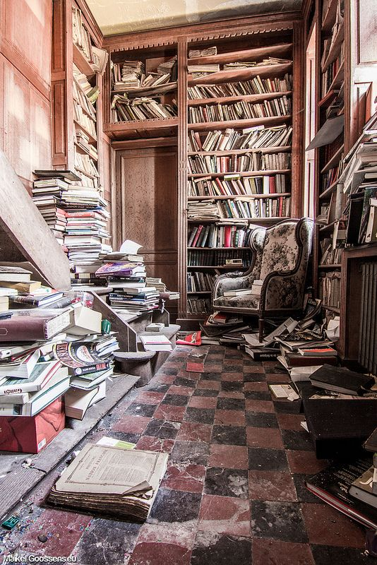 Library in the abandoned Château de la Forêt, Belgium. Man I wanna look thru all those BOOKS!!