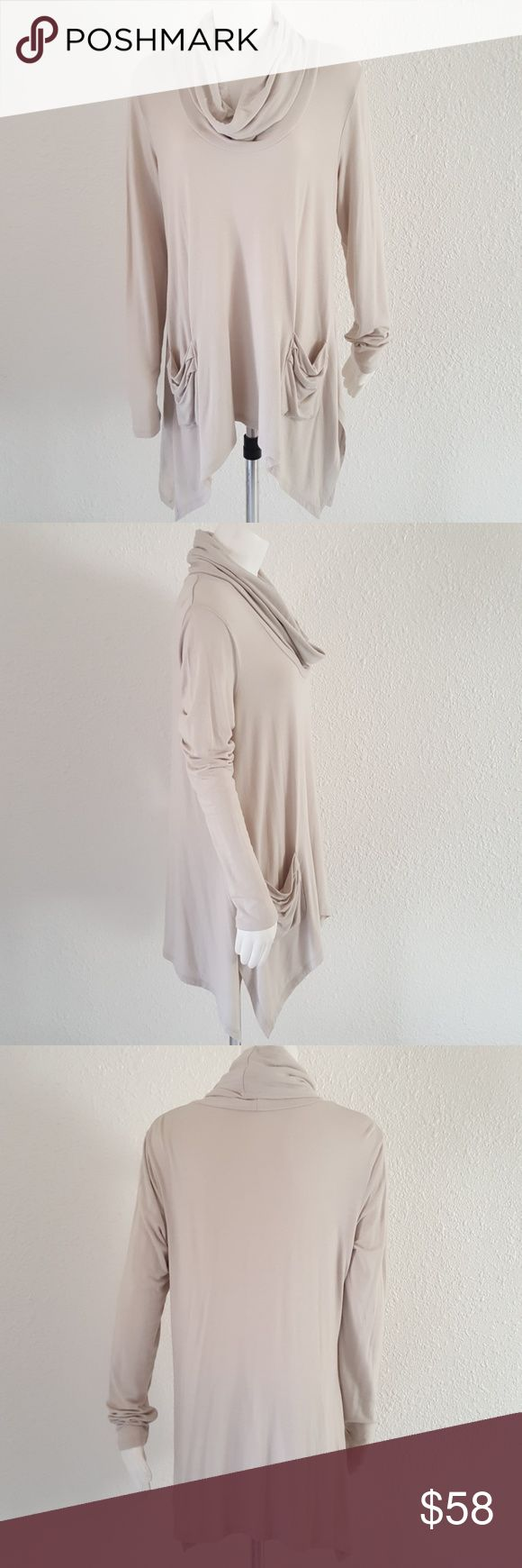 """Andrea Jovine Workshop Asymmetrical Tunic L Gorgeous long tunic from Workshop line by Andrea Jovine. Very light beige stone color. Cowl neck. Long sleeves, asymmetrical hemline. Slouchy pockets on front. Super soft w perfect amount of stretch. Chest 42"""", longest length on sides 34"""", shortest length 30"""", sleeves 26"""". So fabulous perfect for Fall! Andrea Jovine Tops Tunics"""