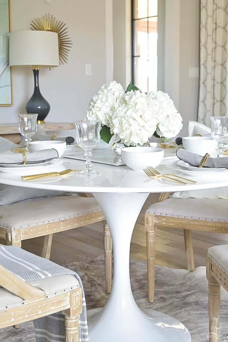 white tulip table with bring white table scape