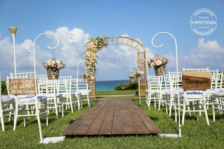 Wedding arch  Wood Hall White chairs Beautiful flowers