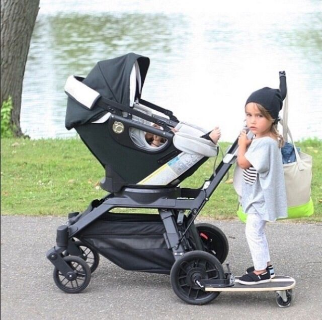 Orbit stroller. Older sibling can stroll along side with attached board.