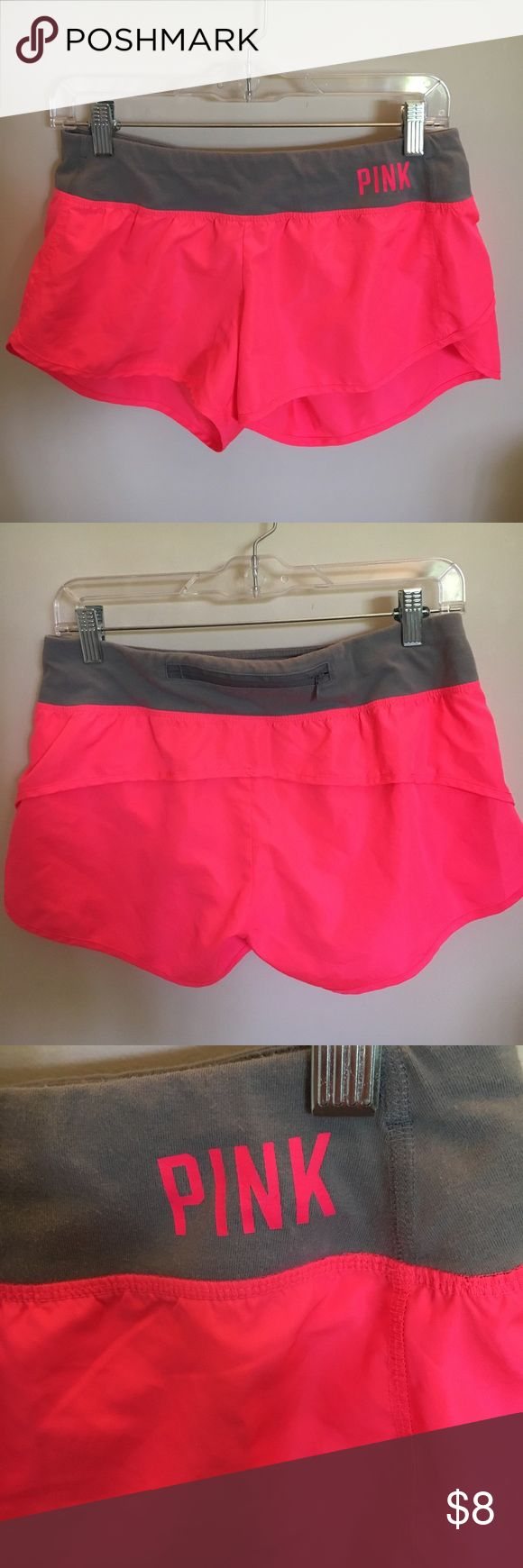 PINK workout shorts Pink workout shorts with back zipper pocket and inner liner --- grey sweat band as waist band slightly worn PINK Shorts