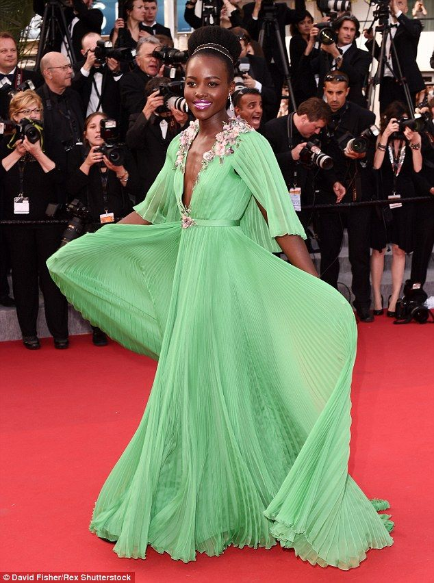 That's one way to shine: She also wore a couple of statement diamond rings on her hands as...