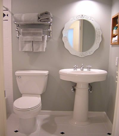 Light grey bathroom for a sophisticated, but airy feel. Could play with some cute accesories to add in a pop of color.