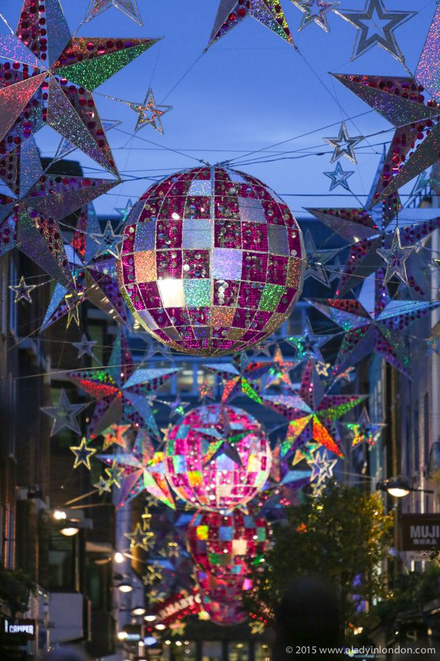 The 5 best places for Christmas ligths in London! The Carnaby Street Christmas lights in Soho are some of the most famous in the city, as they're always big and bright. They're easy to photograph because there are no cars on the street, too!