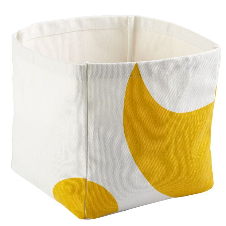 Shop Color Pop Cube Bin (Yellow).  If you think there's something unique about these bins, you are correct.  The cotton canvas bin have different patterns on each side.  They're the perfect way to add a pop of bold color to any room.