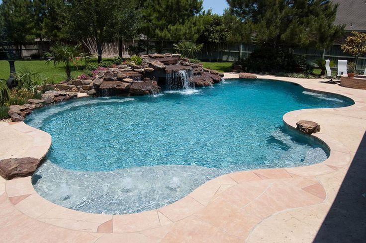 Free form pool, natural waterfall. Swimming Pool Galleries - Cypress Custom Pools