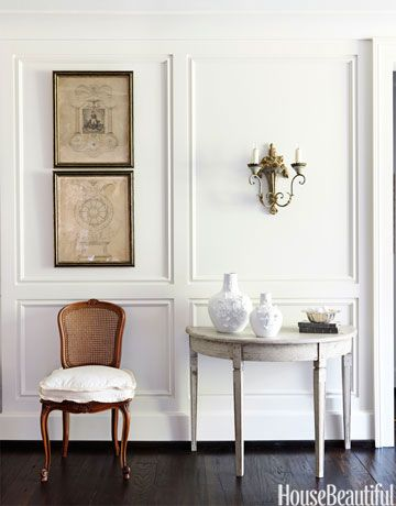 In the entry, Schnell and Davis painted the walls China White by Benjamin Moore.